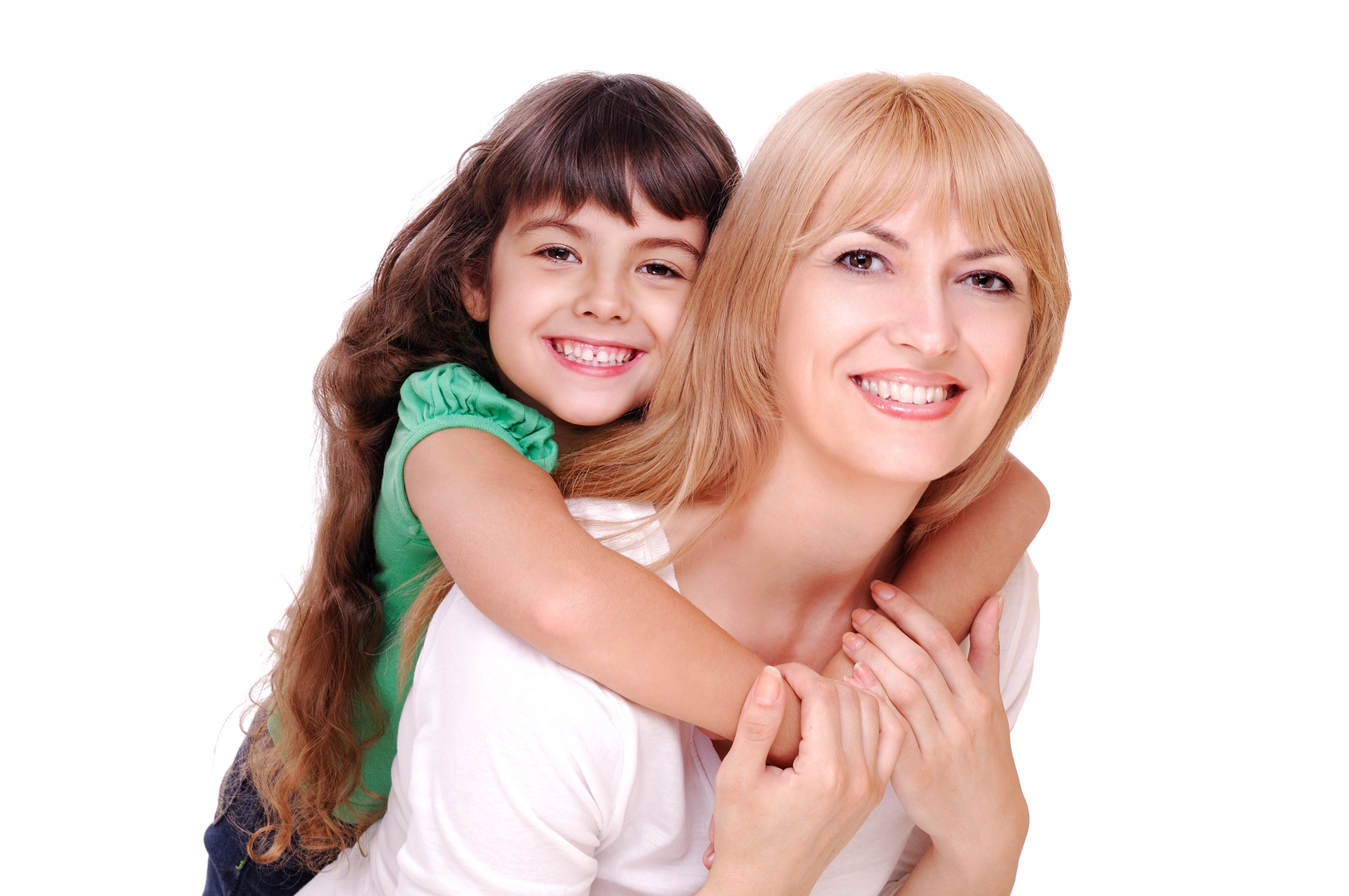 image of a White girl wearinig a green top and jeans hugging a white woman with blnde hair, both are smiling.